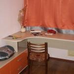 """Детская. Комната девочки. Шкаф-купе, тумба, рабочий стол. Материал ЛДСП Lamarty цв.""""Дуб дымчатый"""", фасады МДФ в пленке ПВХ цв.""""Оранжевый глянец""""."""